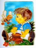Muchacho y miel Imagen de archivo libre de regalías