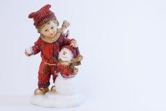 Muchacho y muñeco de nieve Imágenes de archivo libres de regalías