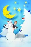 Muchacho y muñeco de nieve Imagen de archivo libre de regalías