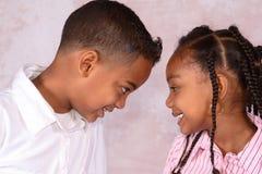 Muchacho y muchacha Fotografía de archivo libre de regalías
