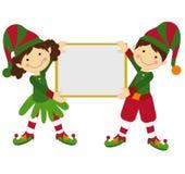 Muchacho y muchacha de la Navidad Foto de archivo