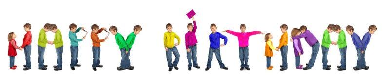 Muchacho y muchacha que hacen palabras el FELIZ CUMPLEAÑOS, collage Foto de archivo