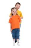 Muchacho y muchacha sonrientes en blanco Foto de archivo