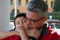 Muchacho y papá Imagen de archivo