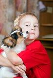Muchacho y perrito Foto de archivo libre de regalías