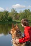 Muchacho y perro Foto de archivo libre de regalías