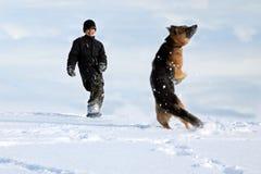 Muchacho y perro Fotos de archivo libres de regalías