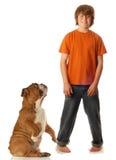 Muchacho y perro adolescentes Fotos de archivo
