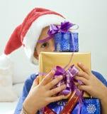 Muchacho y presentes Fotos de archivo libres de regalías