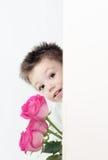 Muchacho y rosas Fotos de archivo