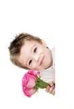 Muchacho y rosas Imagen de archivo libre de regalías