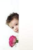 Muchacho y rosas Foto de archivo