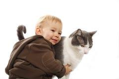 Muchacho y su gato Foto de archivo