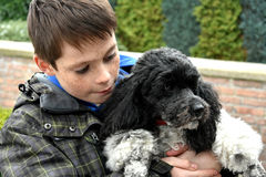 Muchacho y su perro Imágenes de archivo libres de regalías