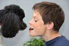 Muchacho y su perro Imagen de archivo