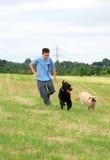 Muchacho y sus perros Fotografía de archivo libre de regalías