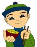 Muchacho y tallarines chinos Imagen de archivo