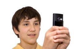 Muchacho y teléfono Imagen de archivo libre de regalías