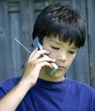 Muchacho y teléfono Fotografía de archivo