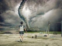 Muchacho y tornado Fotografía de archivo