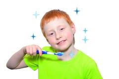 Muchacho y un cepillo de dientes Foto de archivo libre de regalías