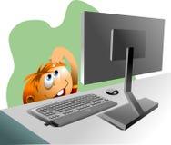 Muchacho y una computadora Foto de archivo libre de regalías