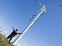 Muchacho y windturbine Imagen de archivo libre de regalías