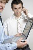 Muchachos/computadora portátil y teléfono celular fotografía de archivo libre de regalías