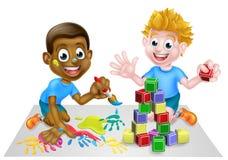 Muchachos de la historieta que juegan con la pintura y los bloques Imágenes de archivo libres de regalías