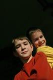Muchachos en un fondo negro Fotografía de archivo libre de regalías