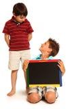 Muchachos felices con la pizarra Foto de archivo libre de regalías