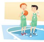 Muchachos que juegan la bola de la cesta Foto de archivo libre de regalías
