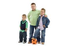 Muchachos que presentan con el balompié Imagen de archivo libre de regalías