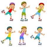 Muchachos y muchachas en pcteres de ruedas Foto de archivo libre de regalías