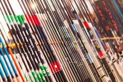 Muchas cañas de pescar en tienda Fotografía de archivo libre de regalías