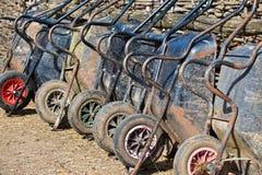 Muchas carretillas en la granja Imágenes de archivo libres de regalías