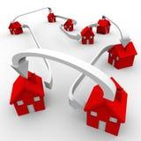 Muchas casas rojas conectaron a la comunidad móvil de la vecindad Imagenes de archivo