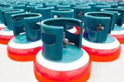 Muchas de las botellas de gas hinchan con butano del propano Imagen de archivo