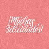 Muchas Felicidades translated from Spanish handwritten phrase Congratulations on pink background.Vector illustration. Muchas Felicidades translated from Spanish Stock Images