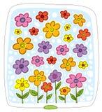 Muchas flores multicoloras en un fondo azul Imagen de archivo