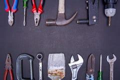 Muchas herramientas en fondo negro Fotografía de archivo