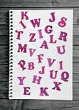 Muchas letras en el cuaderno Imágenes de archivo libres de regalías