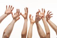 Muchas manos que alcanzan hacia fuera para arriba fotografía de archivo libre de regalías