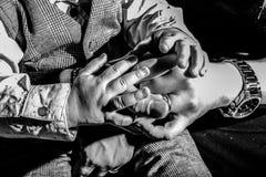 Muchas manos que alcanzan para arriba, aislado en beige Foto de archivo libre de regalías