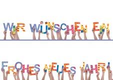 Muchas manos que sostienen Wir Wuenschen Ein Frohes Neues Jahr Imágenes de archivo libres de regalías