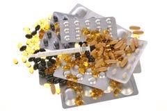 Muchas píldoras dispersadas Fotos de archivo