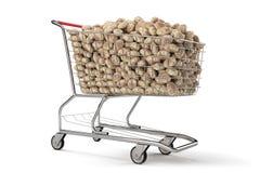 Muchas patatas en un carro de la compra en fondo del blanco del th representación 3d Imagen de archivo