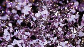 Muchas pequeñas piedras brillantes de la joya que giran almacen de video