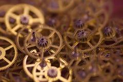 Muchas pequeñas ruedas dentadas Foto de archivo libre de regalías