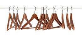 Muchas perchas de madera en una barra Fotos de archivo libres de regalías